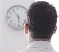 Man looking at clock
